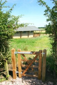 Arrival gate at Village Farm Getaway, holidays glamping and luxury camping in East Midlands and Leicestershire